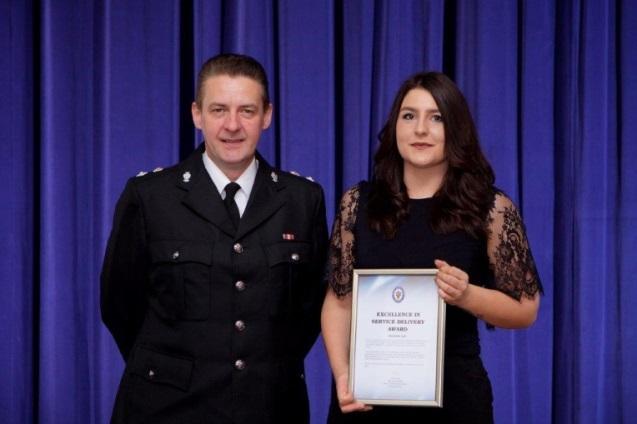 Sergeant Simon Edwards presenting the award to Bernadette Light