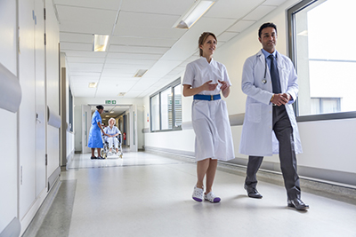 NHS staff walking down a corridor