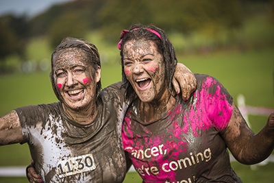 Two woman take part in a fun run to raise money for cancer