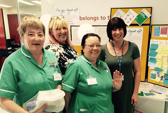 Photo of four women, two are nurses.
