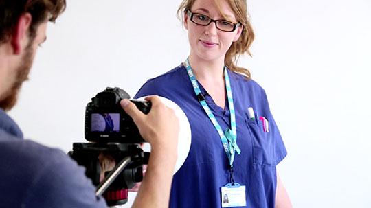 female nurse posing for a photo