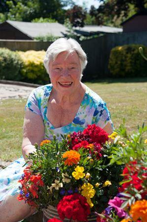 Beryl Langley in her garden