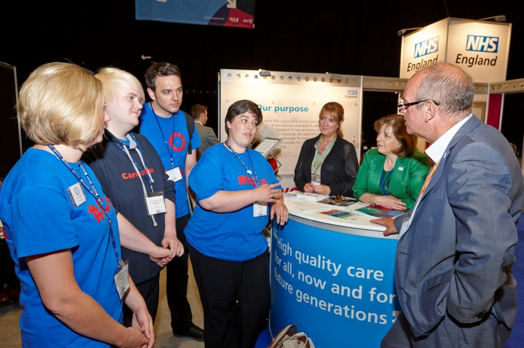 Picture of people talking at the NHS England stand at NHS Confederation 2013