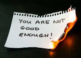Image showing a piece of note paper with the writtens words 'you are not good enough!'