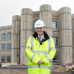 Sir Bruce Keogh at the construction site of the Cramlington Hospital
