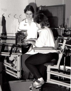 Image of a nurse, with a patient doing some exercise