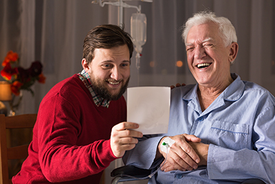 A father and son read a letter