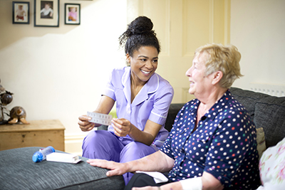 A care worker pays a home visit to a patient