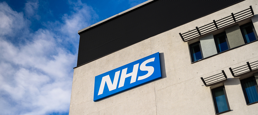 NHS sign on building