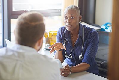 A doctor in discussion with a patient
