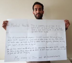 "picture of Dr Ilan Ben-Zion holding a message that reads: Mental Health: This is something we all have. It is a neutral term and does not mean we have good or bad mental health. If you have blood, you have mental health. The #ihavementalhealth campaign is to raise awareness that we all have mental heal. Sometimes it is good and at other times we may have mental ""ill"" health when we have any kind of mental health difficulty. Sometimes we may need support, at other time we may not. We all have mental health and if we can acknowlege that mental health is something we share, it may reduce stigma and be easier to talk about with others when it is not so good and we are struggling. My name is Ilan and #ihavementalhealth"