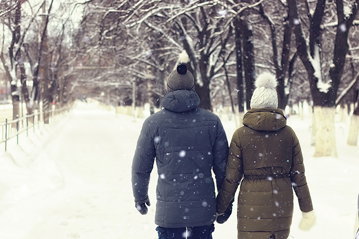 A couple walking in the snow