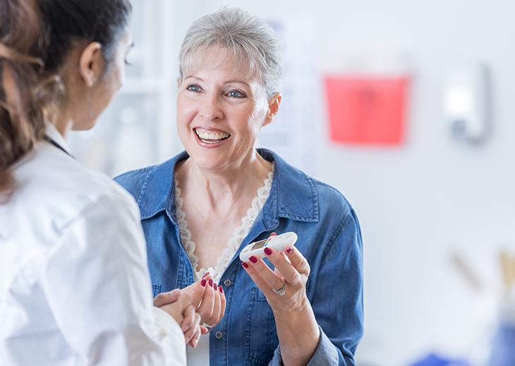 A woman checks her blood sugar level