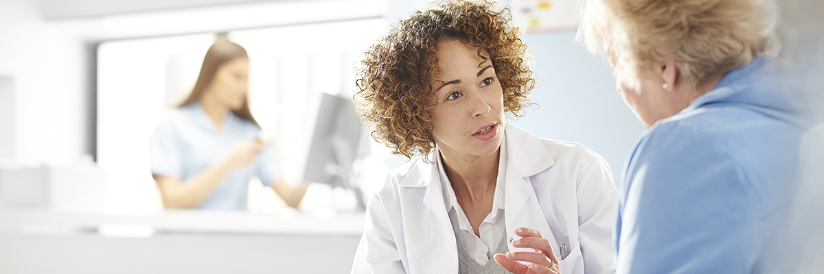 A pharmacist talks with a patient