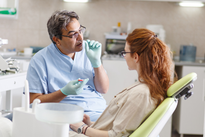 Dentist talking to a patient