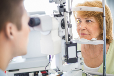 Patient having her eyes examined
