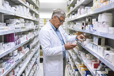 Pharmacist checking tablets
