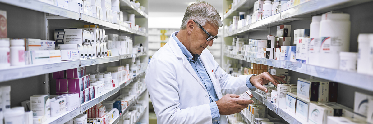 Pharmacist checking tablet labels