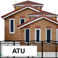 A house that has a sign saying 'ATU' on a brick building