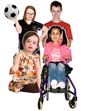 Four children including one in a wheelchair and one with a football