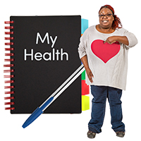 "A lady pointing to herself with a big heart on her jump standing in front of a notebook with the words ""My Health"""