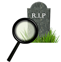 Magnifying glas and gravestone