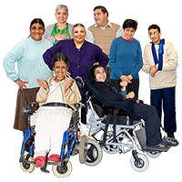A group of people including 2 people in wheelchairs
