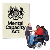 "A man in a wheelchair next to a man who appears to be helping him in front of a notice that reads ""Mental Capacity Act"""