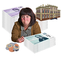 A woman surrounded by piles of money and a large brick building