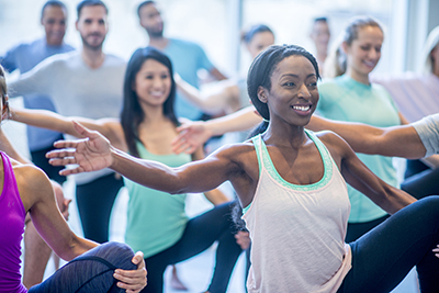 A group of people are taking a dance fitness class