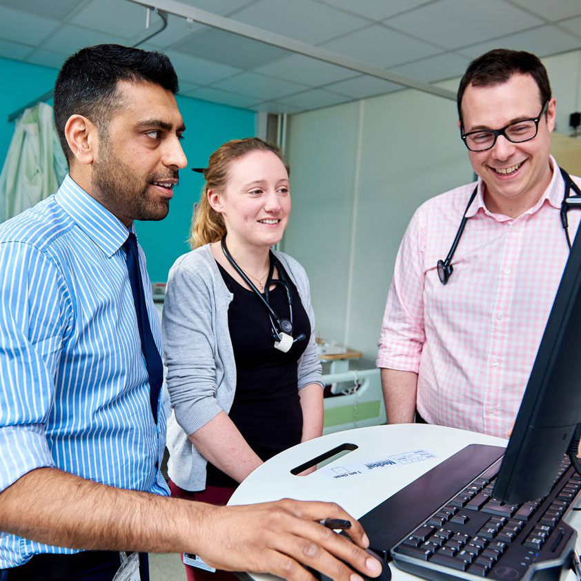 A group of doctors from Sheffield Clinical Commissioning Group (CCG) looking at a laptop