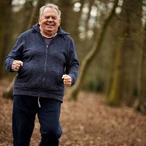 John running in a park