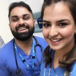 Two A&E staff smiling for a selfie