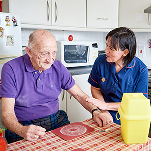 Community nurse and patient at home