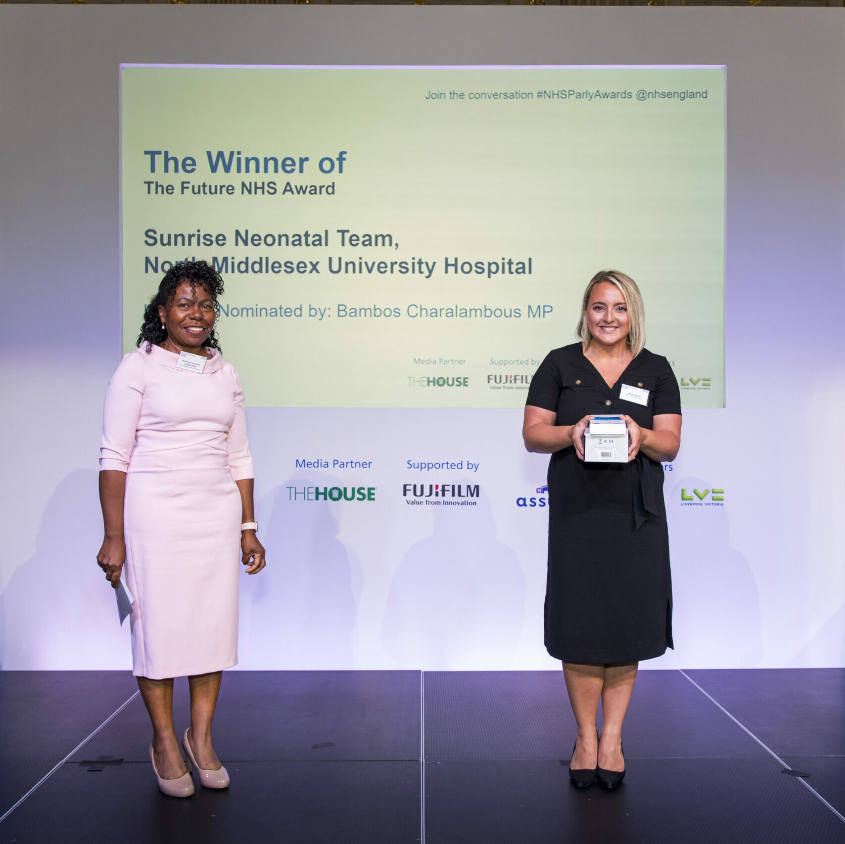A member of the Sunrise Neonatal Team is stood on stage receiving The Future NHS Award